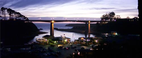 An evening twilight view of the bridge above Noyo Harbor.