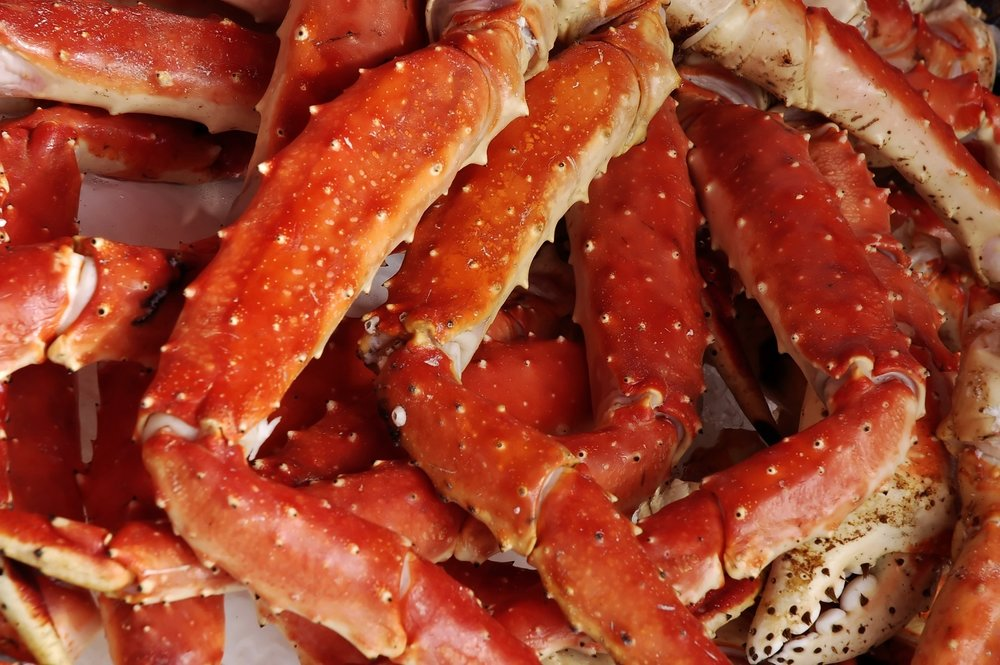 a collection of crab legs, bright red