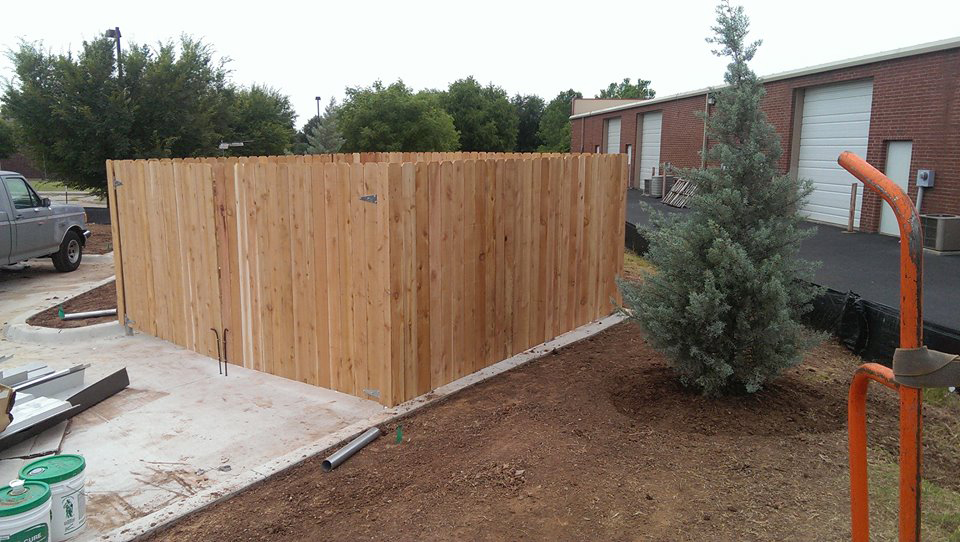 small commercial wood fence for dumpsters