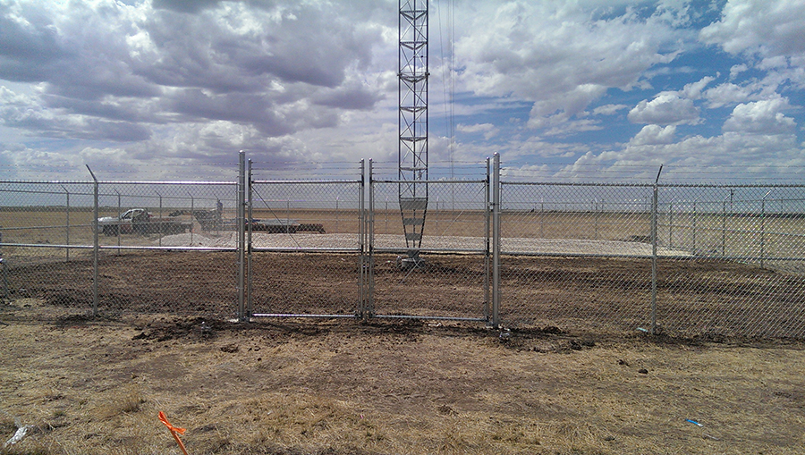 chain link fence surrounding electrical site