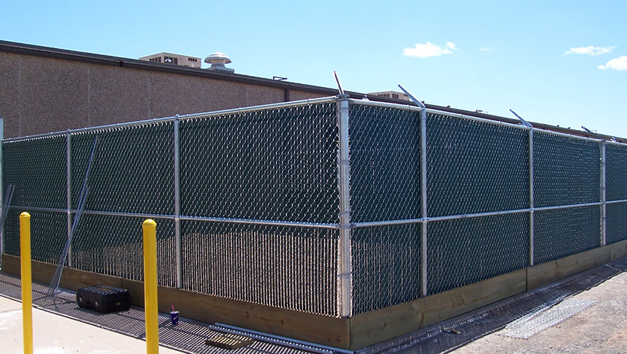 vinyl slats in chain link fence around commercial building