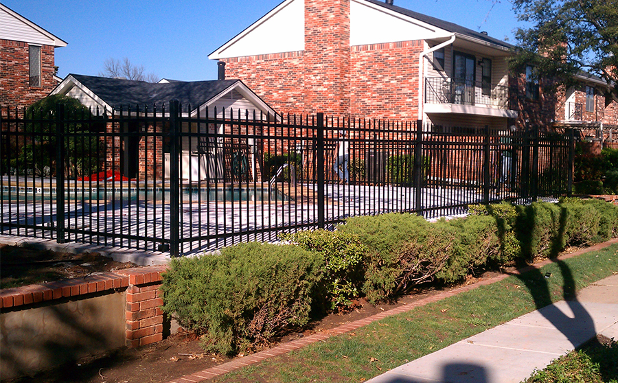 wrought iron fence around backyard pool