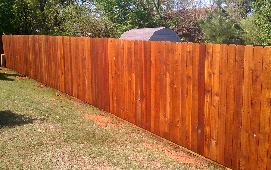 wooden fence in a residential backyard