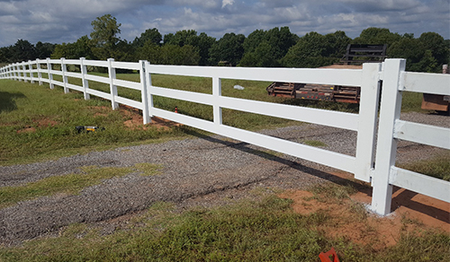 ranch fence surrounding residential property