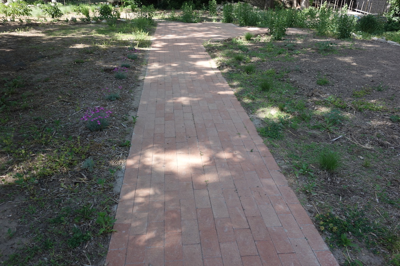 The center walkway is complete at the Inez Alsop Bird Sanctuary. Ms. Alsop loved birds and chose the Northern Flint Hills Audubon Society (NFHAS) to inherit her property at 17th St. near Anderson Ave. in Manhattan, Kansas.