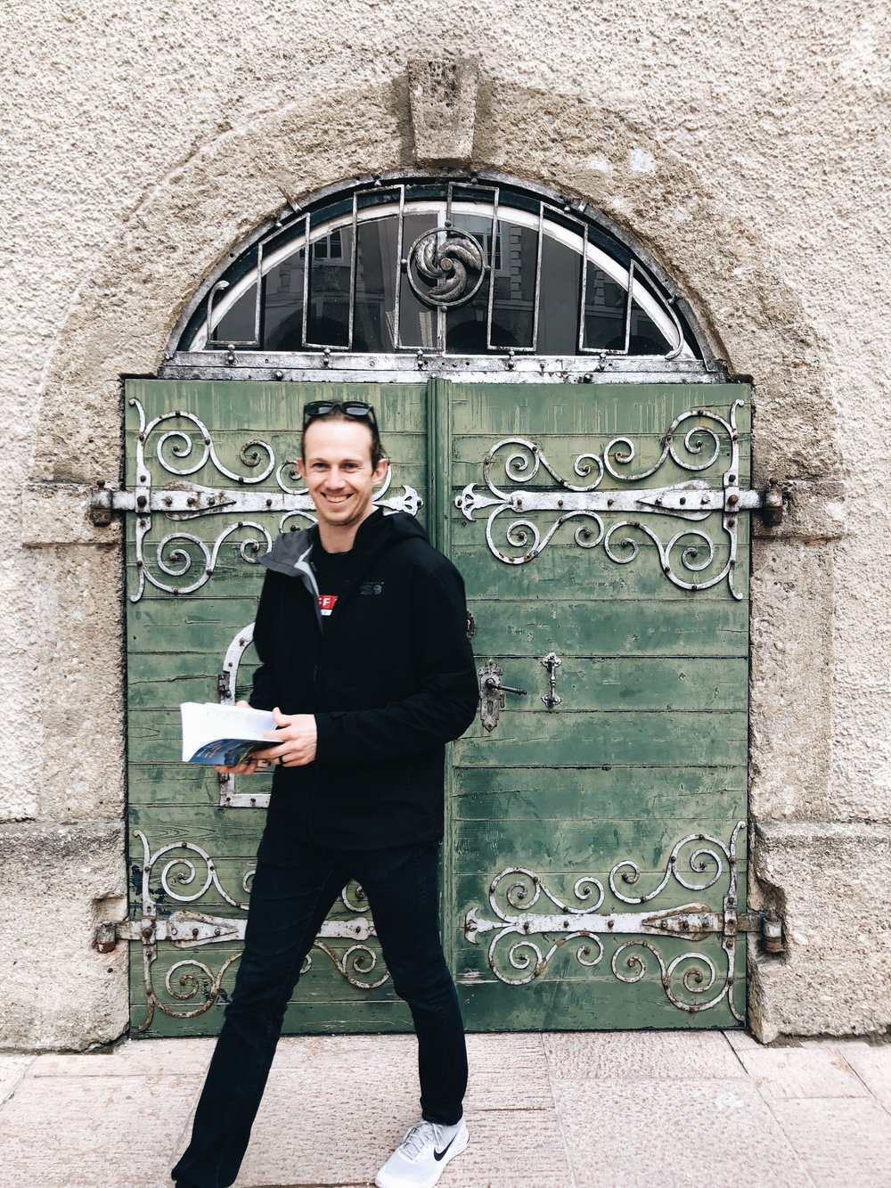 Spencer using the guidebook in Salzburg.