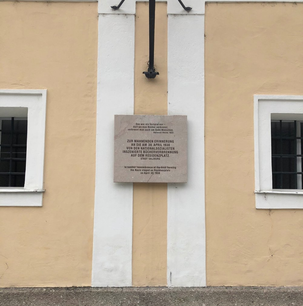 A sign near the palace in Salzburg explaining the details of the Nazi book burning that happened there during World War 2.