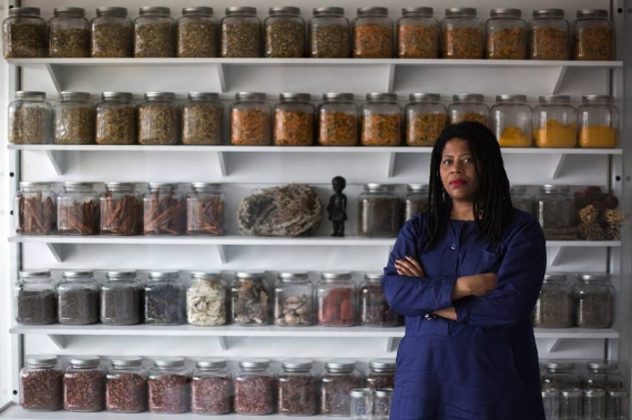 SimoneLeigh, artist-in-residence, in front of a model apothecary that is part of 'The Waiting Room.' Photo: Kevin Hagen for WSJl