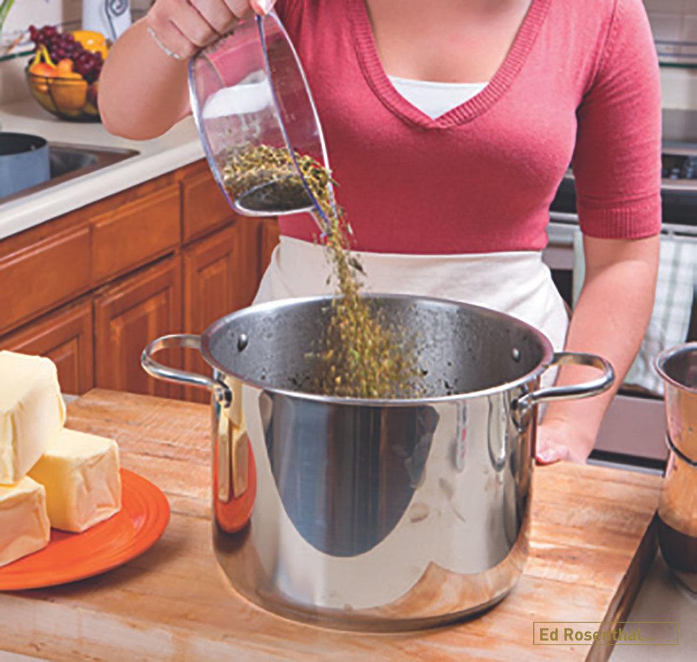 Pouring measured marijuana into cooking pot