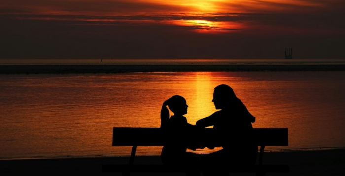 stockvault-mother-and-daughter-at-sunset252634.jpg
