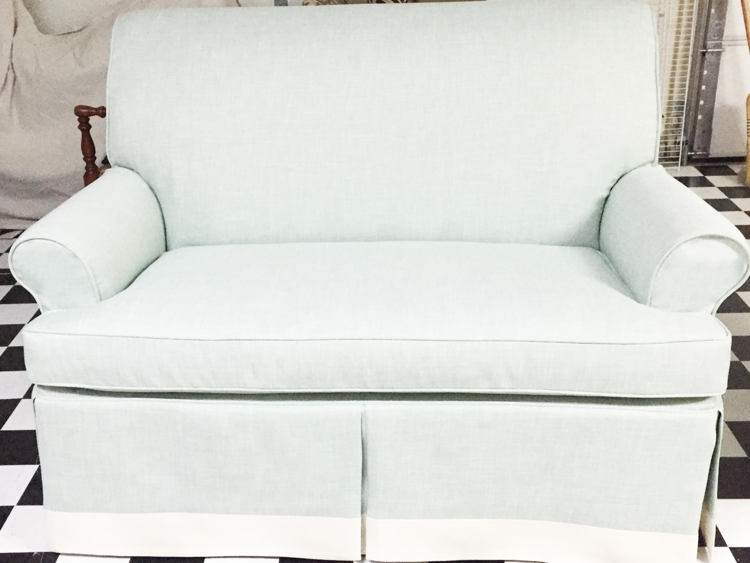 Image via  Sew It Up  of a classic smooth back settee. The lines are simple and the linen fabric will wear out long before it is dated.