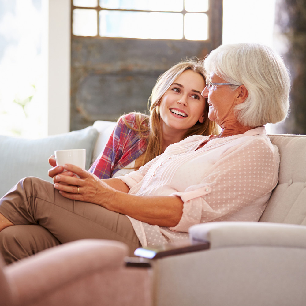 Artsmarketing Services has developed the most successful personal invitation planned giving campaign in the industry. We have operated over 60 campaigns, identified over 25,000 bequests estimated at over 750 million dollars. Image of two multi-generational women sitting on couch together.