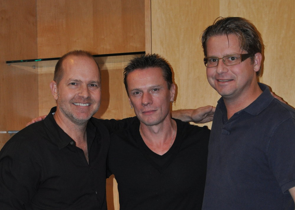 Mike and Patrick Henry with U2's Larry Mullen Jr.