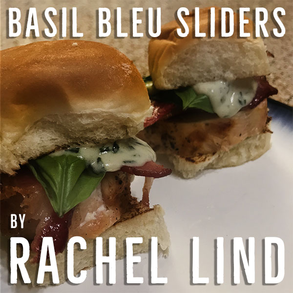 """Grilled slider rolls are topped with bacon and grilled chicken, a fresh leaf of basil and smothered with a thick and creamy basil and bleu cheese sauce that will satisfy all your comfort food needs. These are always served with a side of extra sauce for dipping, because you can never get enough of the creamy goodness."""