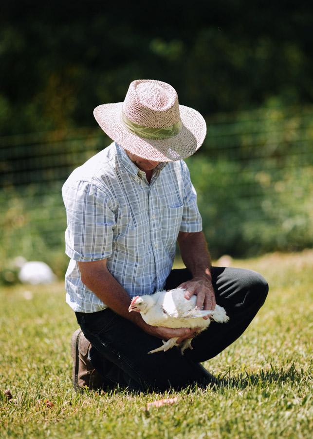 SVO farmer with chicken