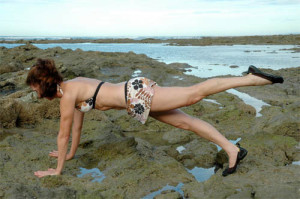 madeline black beach pilates pose