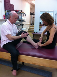 Madeline working on Alan's left toe prior to having him work his feet