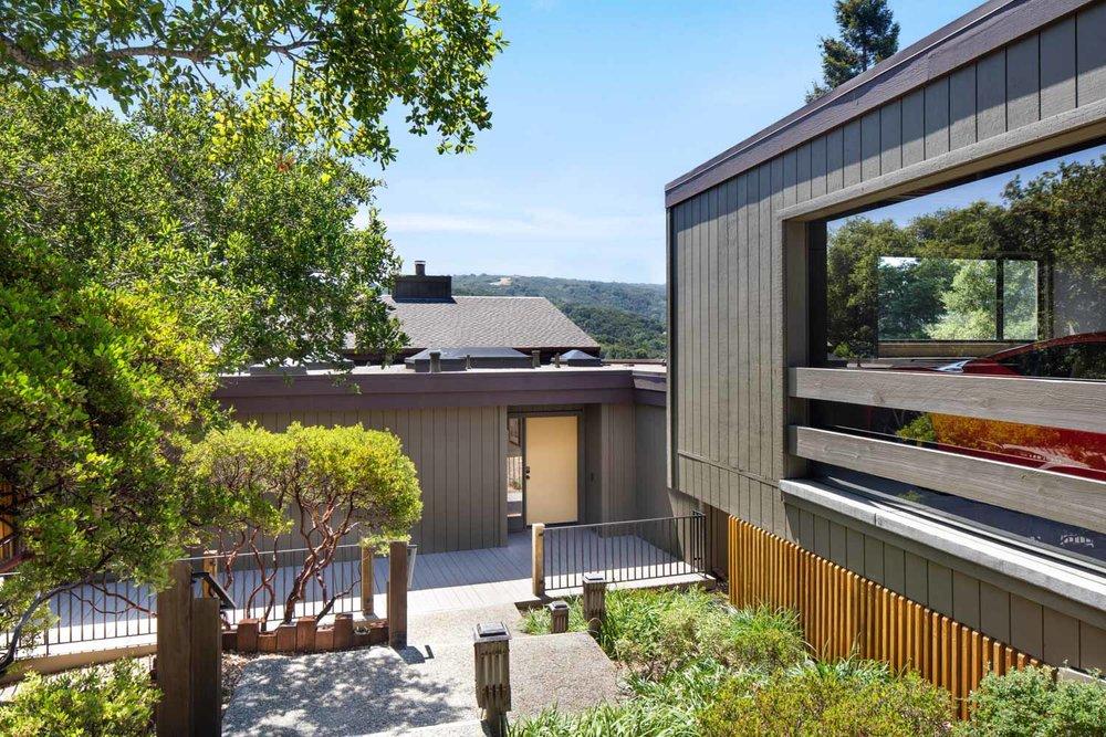 10 Franciscan - front entry & garage.jpg