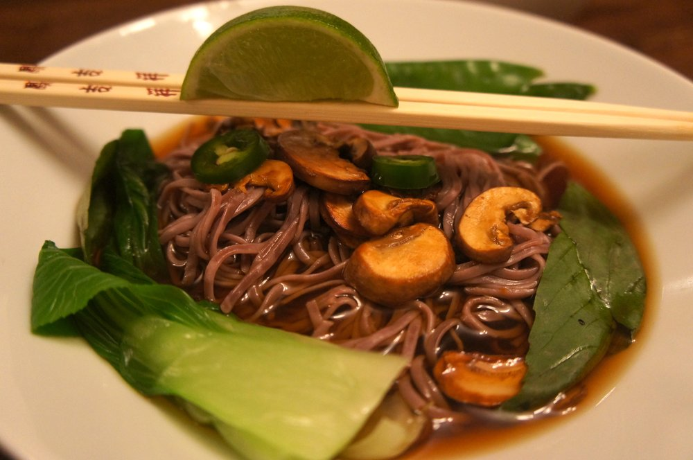 Organic soba noodles in a sweet basil, spicy jalapeno stock with bok choy and mushrooms