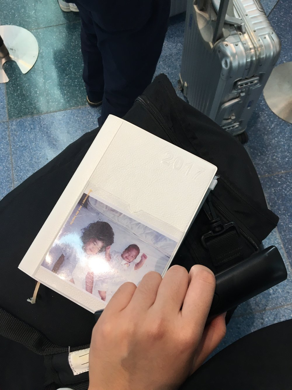 My fifth journal, but I still keep the photo I was given with my first one. - Taken before my flight back to New York from Tokyo.