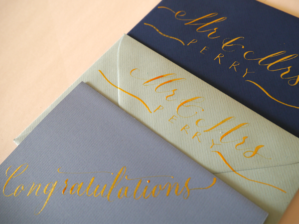 Wedding cards written in gold ink modern calligraphy