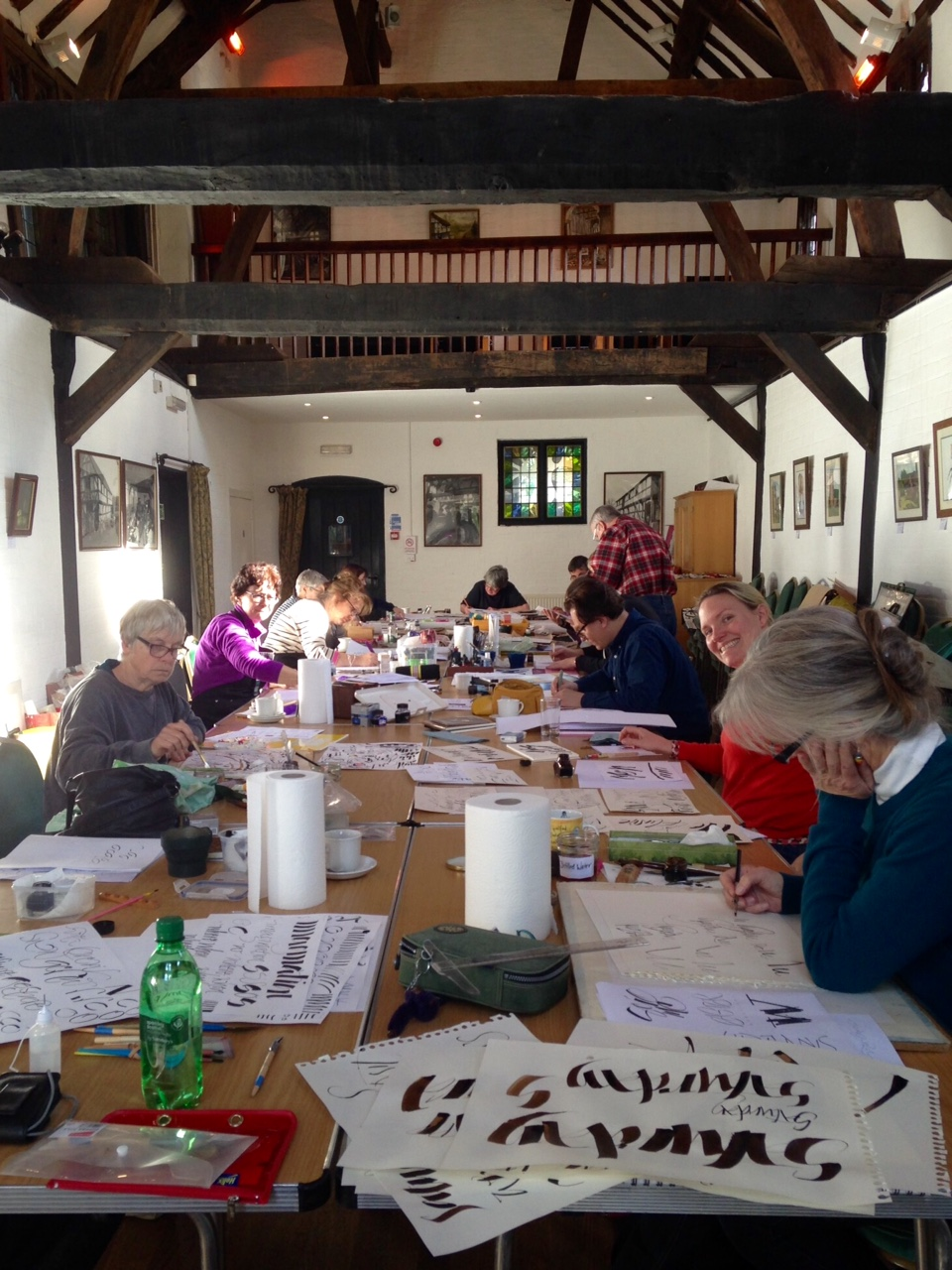 Calligraphers at work learning ruling pen