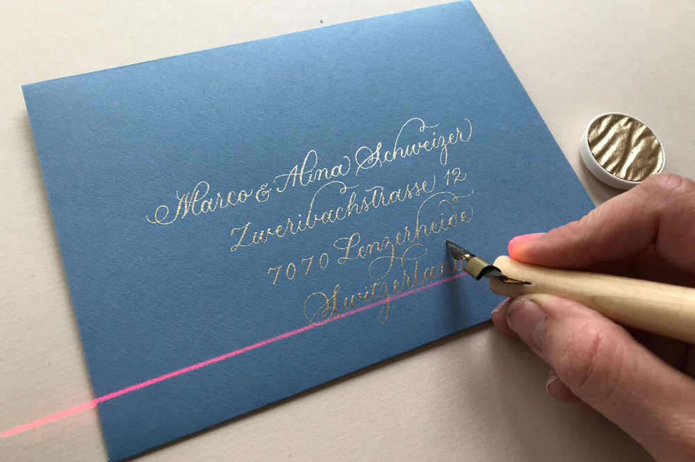 using a laser level to address envelopes in calligraphy