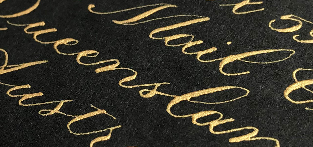 Close up of Dr Ph Martin's Copper Plate Gold Iridescent Ink on black A6 envelope
