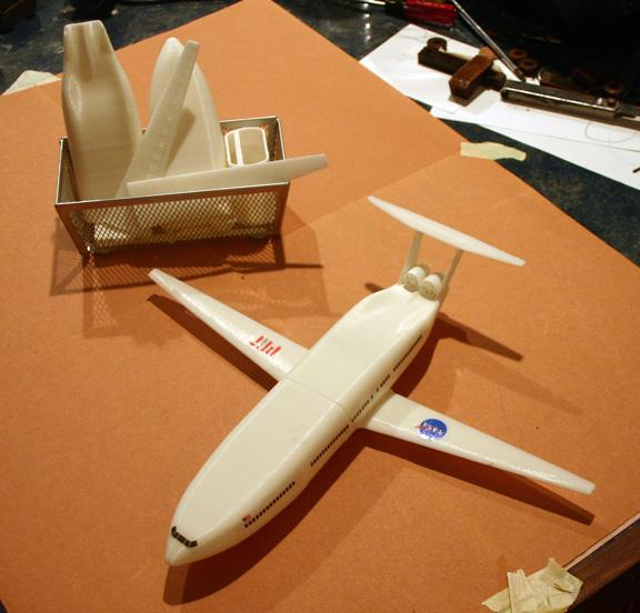 The final plane with a basket of parts for the next plane to assemble (Don Foley)