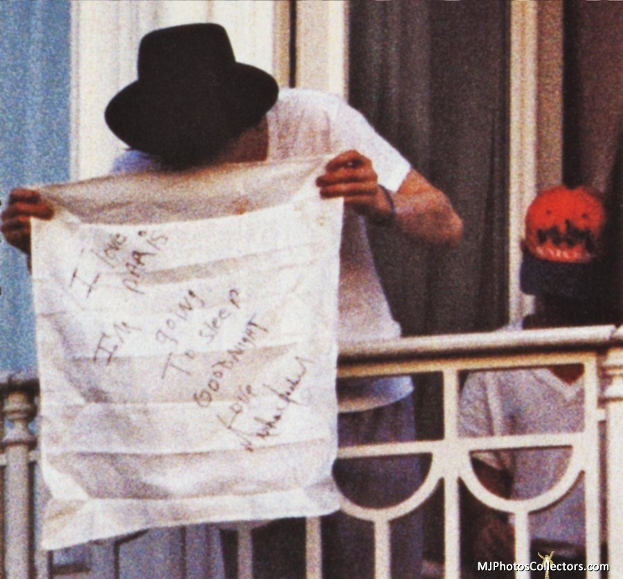 Michael Jackson throwing a pillowcase with a handwritten note