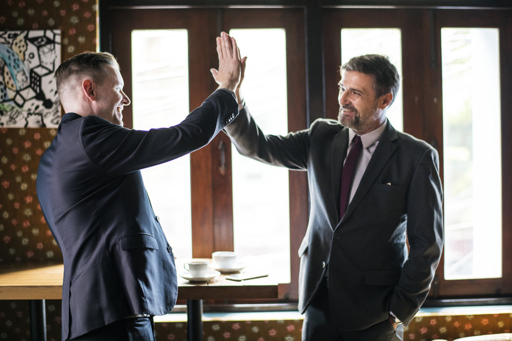 Copia de Businessmen giving a high five