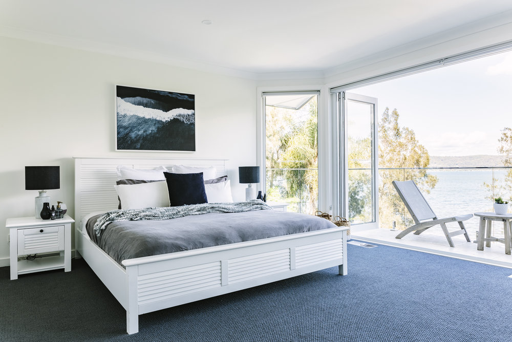 Master Bedroom (Upstairs) - King bed, private balcony with water views and private ensuite with bathtub.Single person AUD $1450 / Double use AUD $1250 each