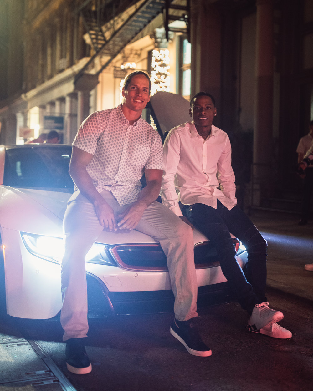 Remy Boy Monty1738 and Thrilla on the hood of his BMW i8