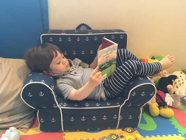 Can you guess which book my grandson is reading?