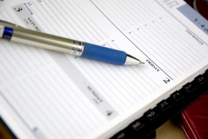 pen point to friday on planner page