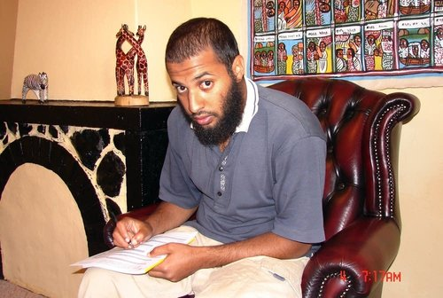 This photo taken in 2007 by a U.S. consular officer and submitted by the subject's father, Mohamed Meshal, shows Amir Meshal, of Bloomington, Minn., filling out a U.S. passport application at Ethiopian National Intelligence and Security Service headquarters in Addis Ababa. Over the past year, Meshal has been banned from at least two suburban mosques over concerns about his influence on young people