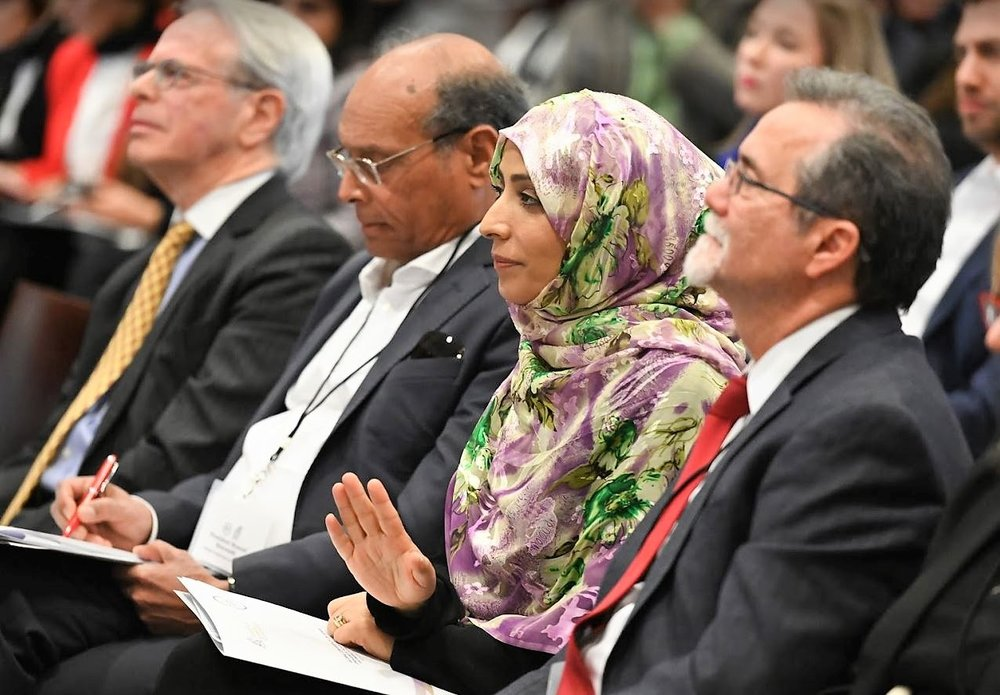 Tawakkol listening to panel.JPG
