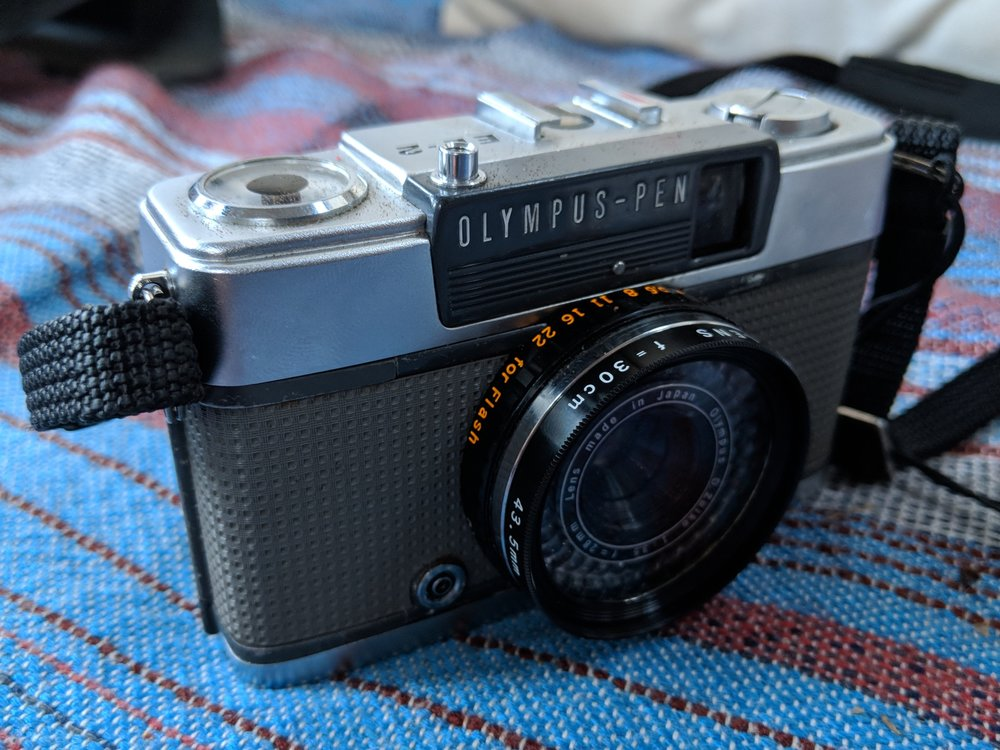 My Olympus Pen EE-2<br>with the close up lens attached