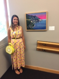 Ti-An DeMartines with her work,  Approaching Positano at Dusk,  at the McMichael Canadian Art Collection.