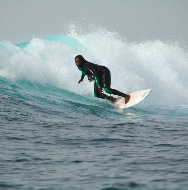 Khadjou Sambe, a pioneer in African women's surfing, shredding at home in Senegal