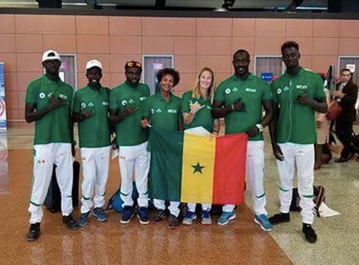 Members of FSS pose with the new member of Team Senegal.