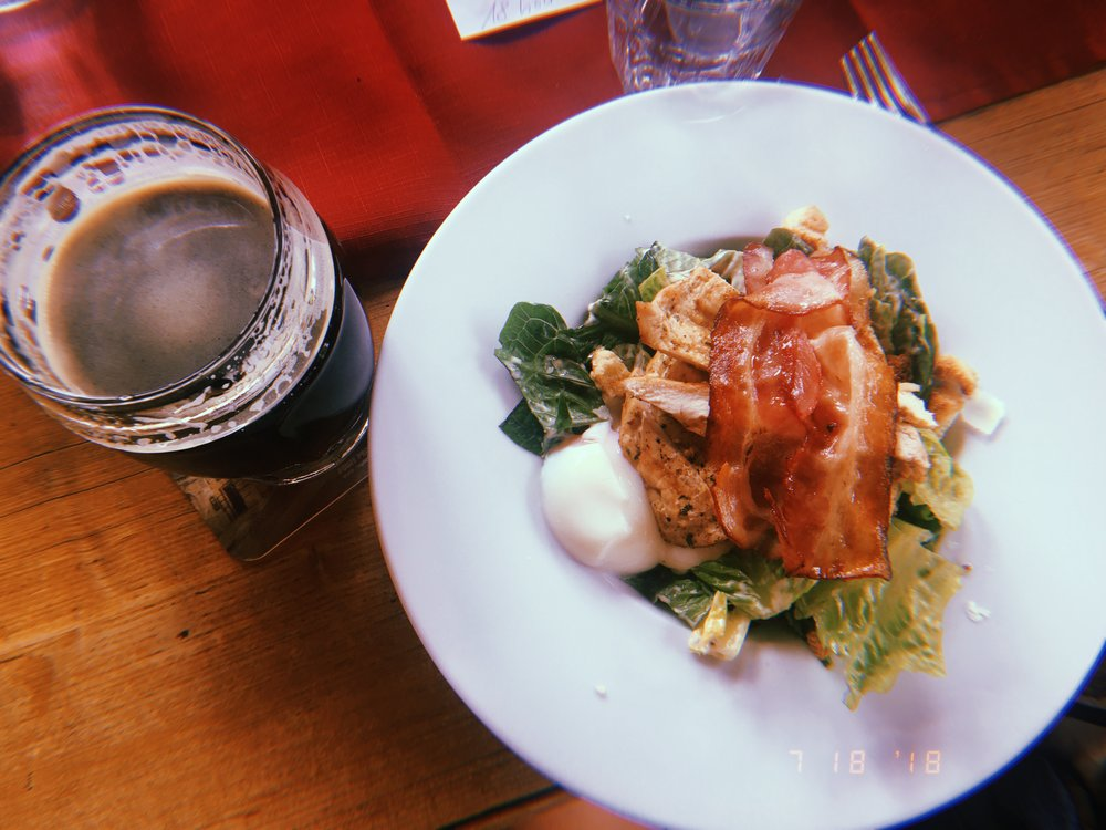 Lunch in Kutná Hora   signature chicken caesar with bacon + poached egg, Kozel dark lager