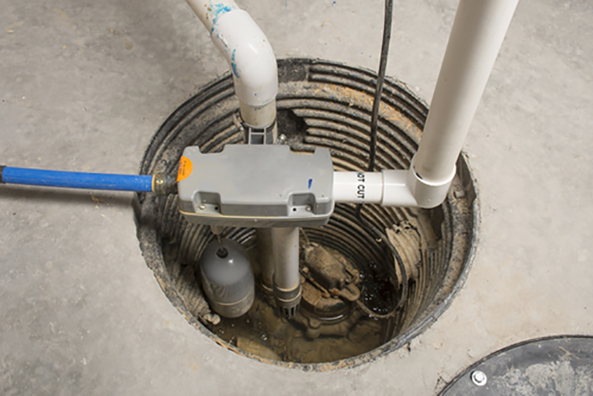 stock-photo-a-sump-pump-installed-in-a-basement-of-a-home-with-a-water-powered-backup-system-438086191.jpg