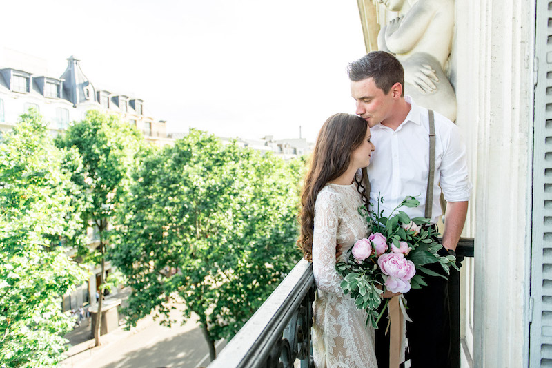 This hot couple on the balcony of the Grand Hotel, Paris.