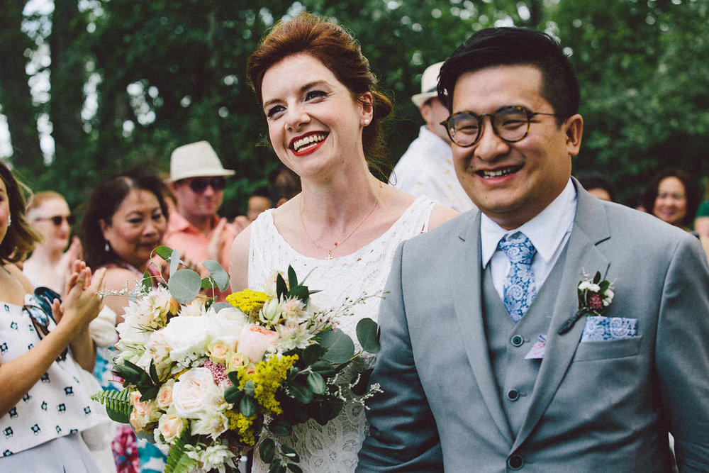 All smiles! Caroline and An sid their I-Do's on Toronto Island. Bridal makeup by Maya Goldenberg.
