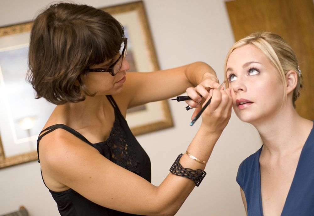 Doing last minute touch-ups on Louise before her wedding. Photo courtesy of Blushing Bride Studios.