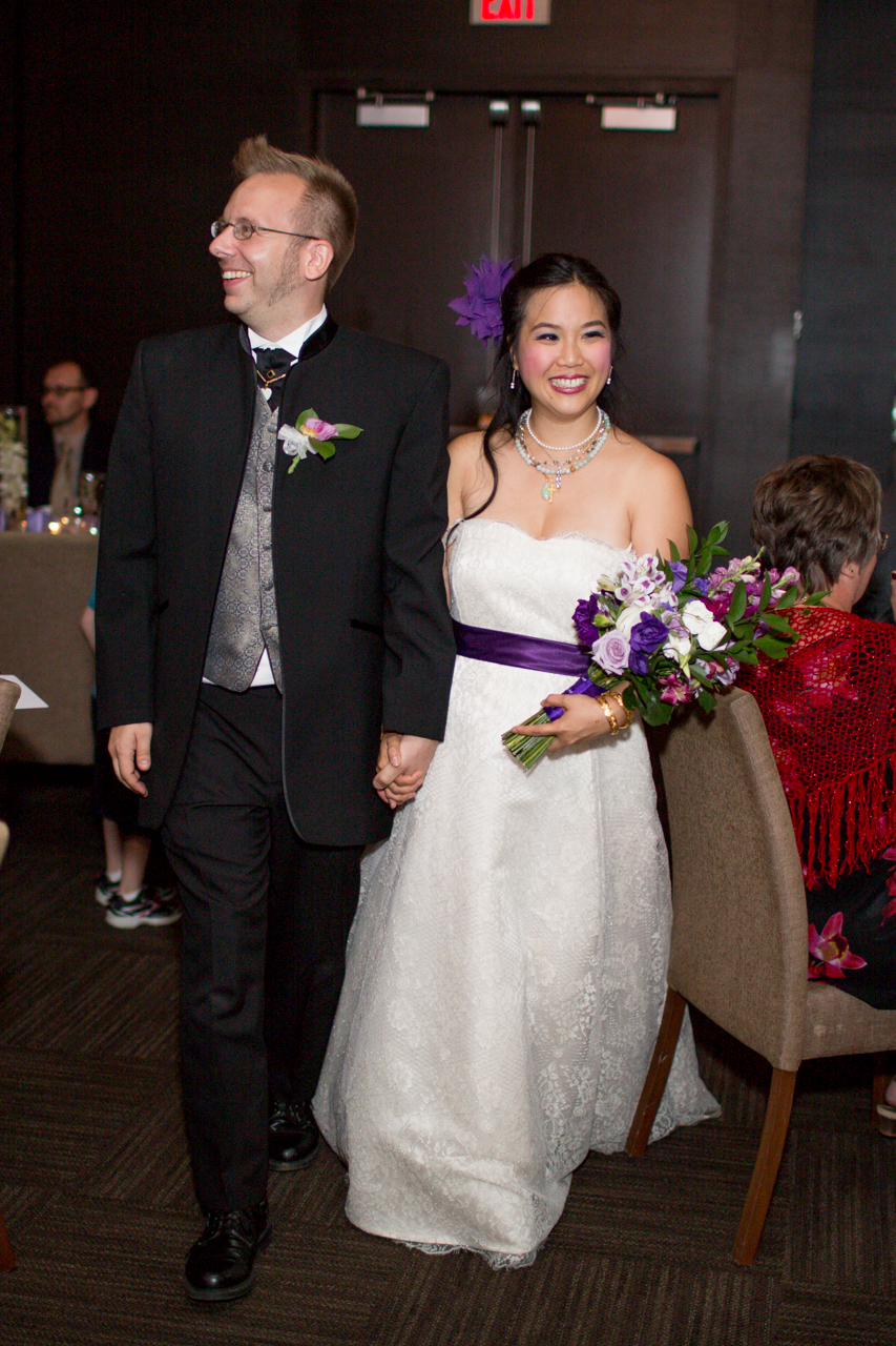 Kat and Gareth walking into the reception! Bride's makeup and hair by Maya Goldenberg.