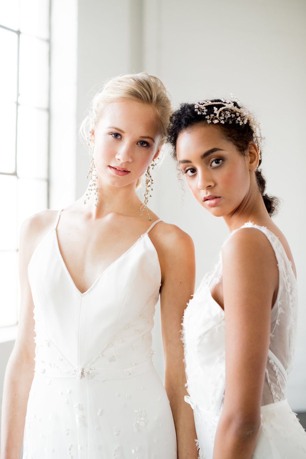 """FeAtured on the Want that Wedding blog, Catherine's Langlois' 2018 """"White Canvas"""" collection of couture wedding gowns. All photos by Whitney Heard. All makeup by Maya Goldenberg. All hair by Ladylyn Gool. Shot on location at Ikonica image studios, styling: The Loved One. Models: May (Plutino) and Eve (Chantale Nadeau)."""