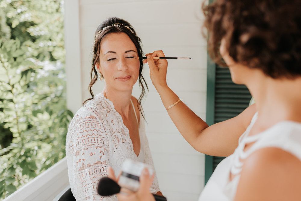 Maya, putting the finishing touches on Kara B.'s makeup! Hair by Shanna Layton for Maya Goldenberg Eco Beauty Pro Team. Photo by Sara Monika Photo.