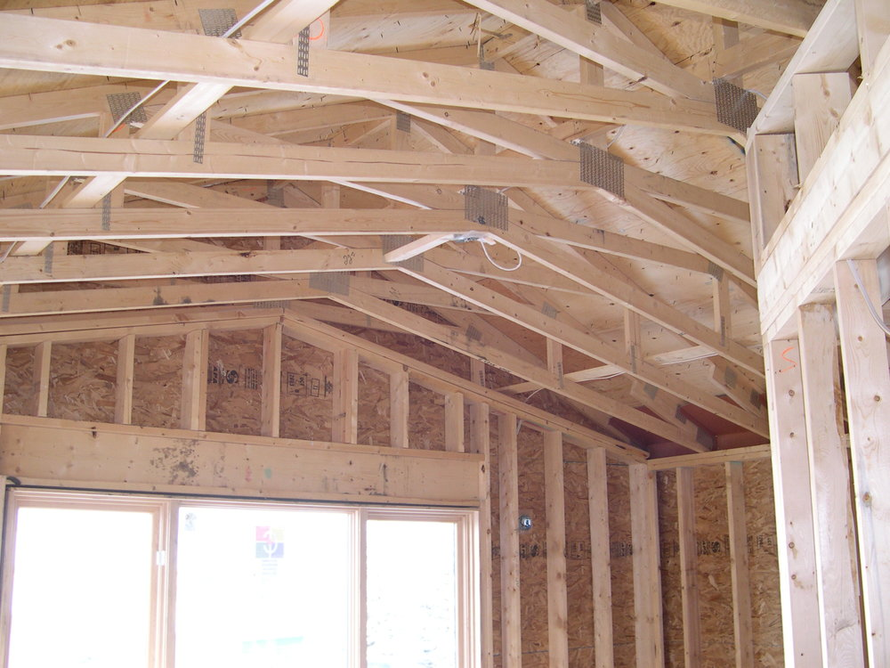 Scissor trusses being installed at a custom home renovation project in North Glenmore Park, Calgary